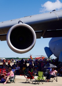 big aircraft (a C5 Galaxy) sheltering some all-Americans